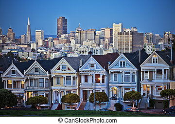 The Painted Ladies of San Francisco, California sit glowing...