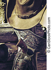 cowboy gun and hat outdoor - gun and hat outdoor under...