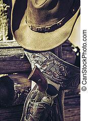 cowboy gun and hat outdoor - gun and hat outdoor under...
