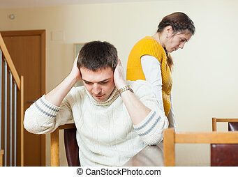 Couple quarrel - Couple quarrel. Sad man listening to woman...