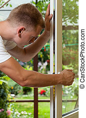Handyman working at home - Young handsome handyman working...