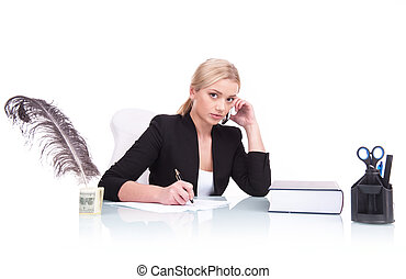 Portrait of serious business woman sitting on her desk...