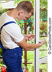 Man during window frame reparation - Young man during window...