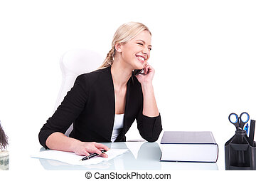 Portrait of happy business woman sitting on her desk...