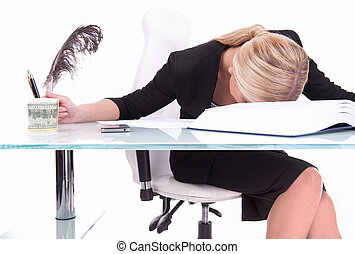 Young businesswoman sleeping on desk beautiful young woman...