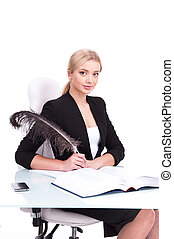 Young businesswoman working on white background and looking...