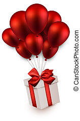 Gift box on red balloons - Gift box with red bow flying on...