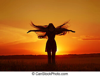 girl silhouette in the field