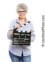 Elderly woman holding a clapboard - Happy elderly woman...