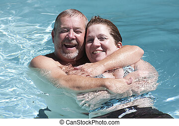 Couple Hugging in a pool