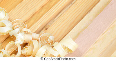 shavings and planks at workplace of a carpenter