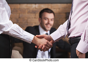 Business people shaking hands after meeting in cafe. Business team shaking hands in cafe