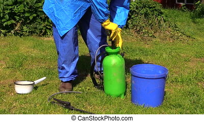 male hand mix fertilizer - man hand with the blue work...