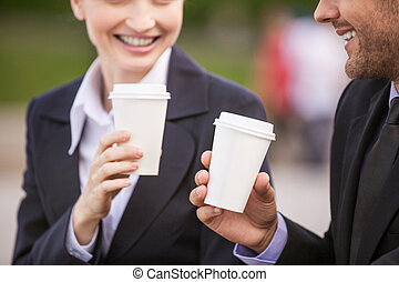 Business people drinking coffee outside Business partners...