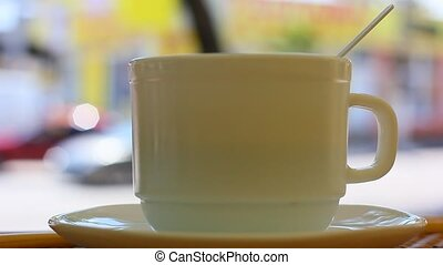 Coffee cup with street background