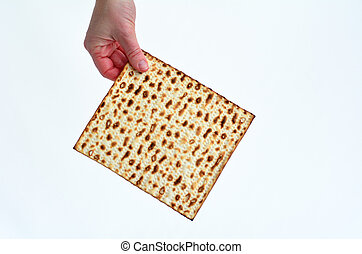Matza - Passover Jewish Holiday - Jewish woman hand holds...