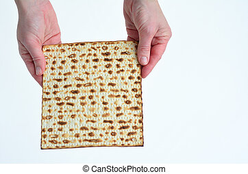Matza - Passover Jewish Holiday - Jewish woman hands holds...