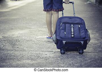 schoolgirl walk alone to school with school bag
