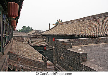 roofs of Pingyao ancient town - stone decorated roofs of...