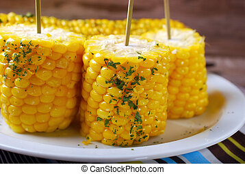 sweet corn with butter and herbs - boiled sweet corn cobs...