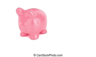 piggy bank with gold coins breaking