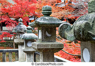 Granite lanterns in the wild garden of temple