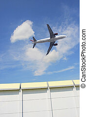 jet airplane - the airplane on the blue sky background