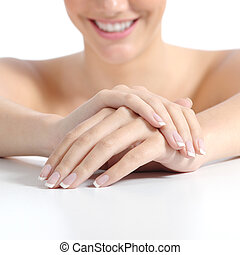 Beautiful woman hands nails with perfect french manicure...