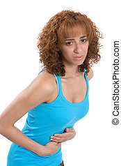 Stomachache - A young woman bends over, reacting to her...