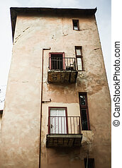 old building with balconies and windows, crack, scratches...
