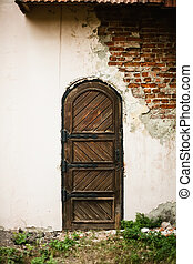 old medieval door in the destroyed building - old wooden...