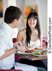 Woman Dining with Partner - A young and attractive woman...