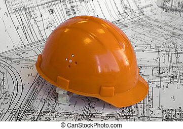 Orange constructional helmet and project drawings. Business...