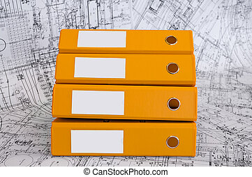 Yellow binder folders in the design drawings - Row from the...