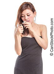 Chinese woman in black dress lighting a cigarette - Asian...