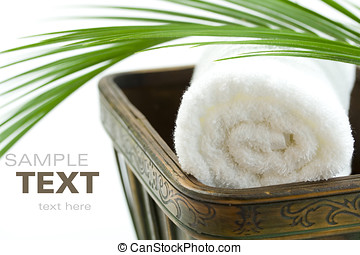 Spa Bath Towel and palm leaf in wooden bowl