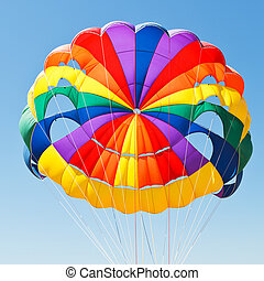 canopy of parachute for parasailing in blue sky