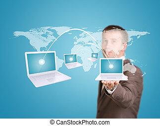 Businessman hold virtual world map with laptops -...