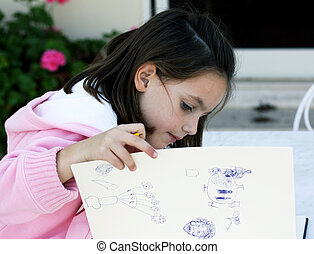 child drawing - a child drawing pictures in the garden