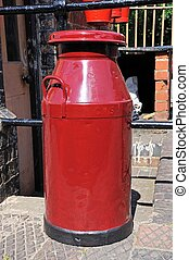 Red milk churn. - Old Retro red painted milk churn on the...