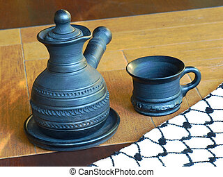 Ceramic coffeepot and cup. - Ceramic coffeepot and cup on a...