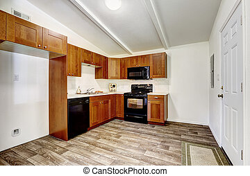 Kitchen cabinets with black appliances