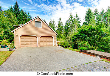 Two car garage with driveway