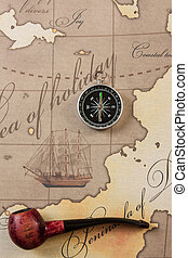 tobacco pipe and compass on map - tobacco pipe and a compass...
