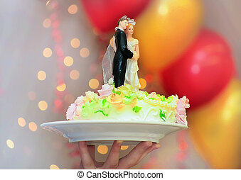 wedding cake with figures of groom - top part of wedding...