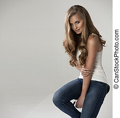 Fashionable young attractive blonde woman posing , studio...