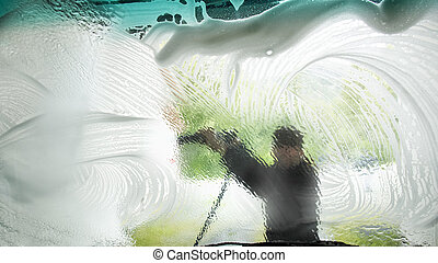 At the Car Wash - View from inside a car being washed at a...