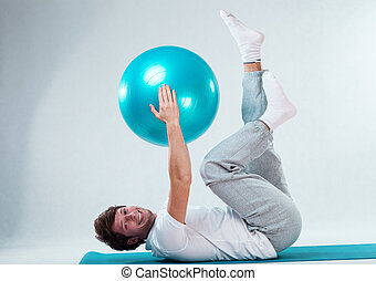 Happy patient training with fitness ball - Happy patient...