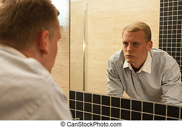 Man with hangover in a bathroom, horizontal