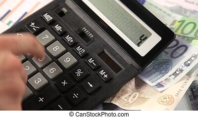 Business man working with calculator in the office. Account...
